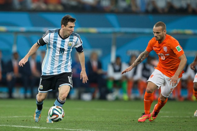 SAO PAULO, BRAZIL - July 9, 2014: MESSI of Argentina and SNEIJDER of Netherlands compete for the ball during the World Cup Semi-finals game between Netherlands and Argentina at Arena Corinthians.